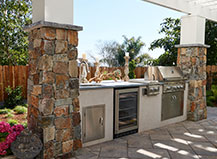 Attached Pergola With Stone Outdoor Kitchen