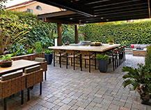 Attached Pergola With Natural Stone Outdoor Kitchen