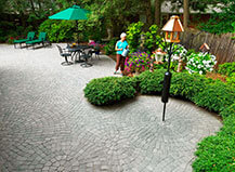 patio tree lined gray paver stones