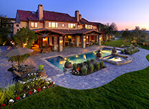 Dramatic Patio And Pool Paved Backyard