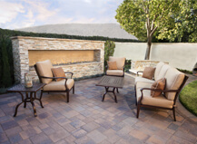 Red And Brown Patio Pavers With Wall Fireplace