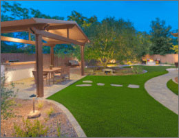 Gabled Pergola With Landscape Lighting And Artifical Turf