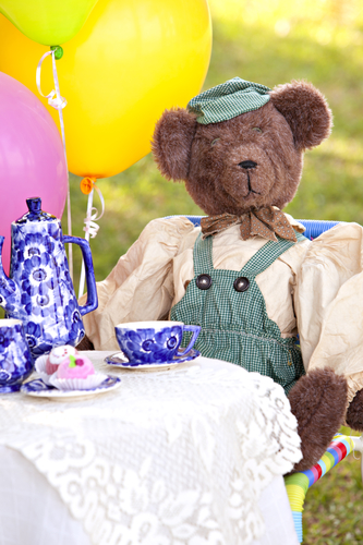 teddy bear on picnic blanket