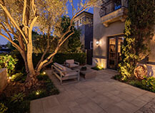 Paver Patio With Landscape Lighting Design