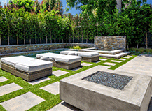Modern firepit design with pavers and turf