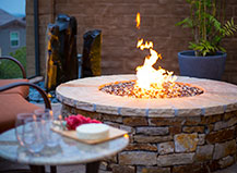 Natural Stone Circular Firepit With A Water Feature