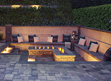 L Shaped Firepit With Seating And Pavers