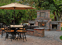 Backyard With Outdoor Fireplace And Seating