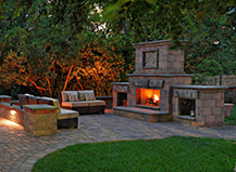 Backyard With Outdoor Fireplace And Artifical Turf