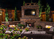 Large Capri Outdoor Fireplace With Landscape Lighting
