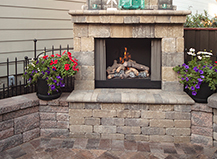 Backyard Outdoor Fireplace With Accent Plants