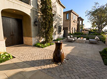 Herringbone Design Paver Entryway With Vase Style Water Feature