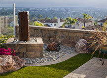 Retaining Wall Patio With Tranquil Water Feature