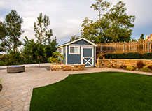 Backyard Paver Patio With Contemporary Fire Bowl