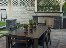Contemporary Style Paver Patio With Outdoor Dining Room And Pergola