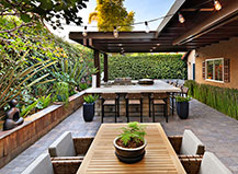 Attached Pergola With Outdoor Lighting And Kitchens