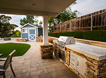 Natural Stone Bbq Island With Covered Pergola