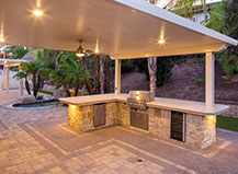 Attached Pergola With A Bbq Island And Outdoor Lighting