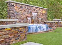 Natural Stone Water Feature With Artificial Turf