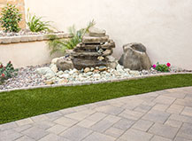 Natural Stone Water Feature With Turf And Accent Rocks