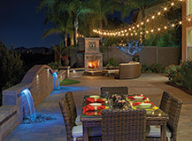 Backyard With Capri A Water Feature, Fireplace And Landscape Lighting
