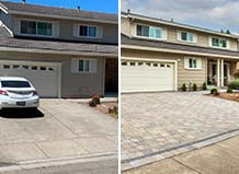 Driveway Remodel With Cool-Tone Pavers And Charcoal Border