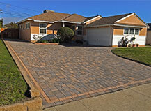 Warm Toned Paver Driveway With A Custom Paver Border