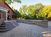 Enclosed Paver Patio With Steps And Wall Design