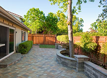 Backyard Paver Patio With Matching Accent Wall