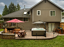 Paver Patio With Jacuzzi And Stone Sitting Wall