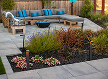 Paving Stone Patio With Lounging Area And Fire Pit