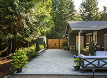 Paver Patio In Cool-Tones With Lounging Area