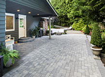 Grey Colored Paver Patio With Steps And Seating Area