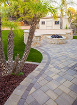 Natural Tone Paver Walkway Leading To Paver Patio