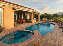 Dark Red Stone Pool Pavers With Hot Tub