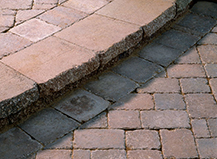 Angled Grey Front Yard Walkway Pavers With Border