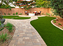 Backyard Walkway Pavers With Artificial Grass And Fire Pit