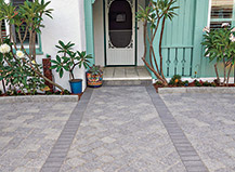 Gray Paver Design Defined Walkway Within Driveway