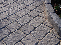 Gray Paver Design With Large And Small Pavers