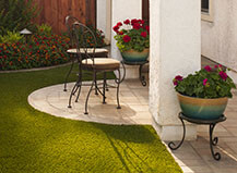 Artificial Turf Lawn With Paver Patio And Seating Area