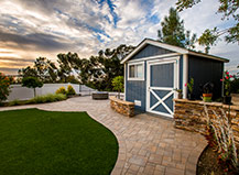 Natural Stone Wall And Artificial Turf With Walkway Pavers
