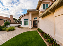 Artificial Turf Lawn With Taupe Paving Stone Walkway