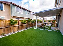 Artificial Turf Lawn With Covered Paver Patio