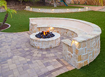 Natural Stone Circular Firepit With Crescent Seating  And Artificial Turf