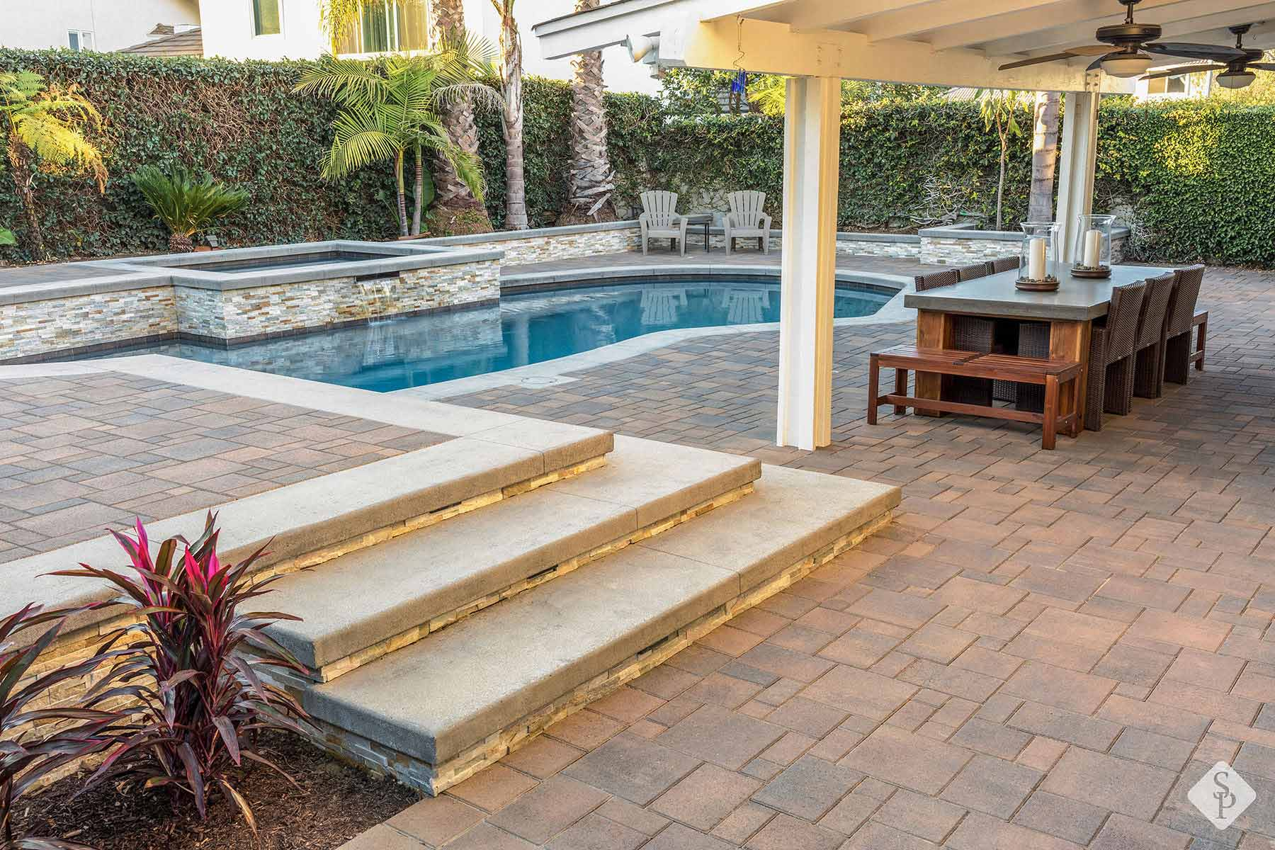 Many materials are available for pool surfaces, but one stands out: Pavers. Here's why: