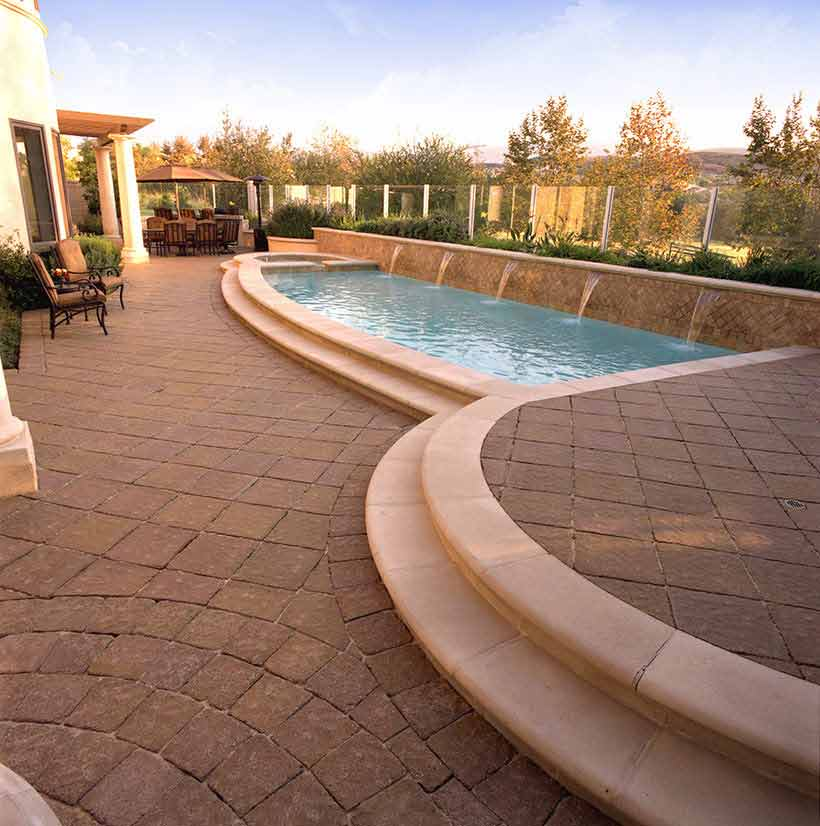 No pool is complete without a deck, and opting for stone pavers ensures you have a unique style for your backyard.