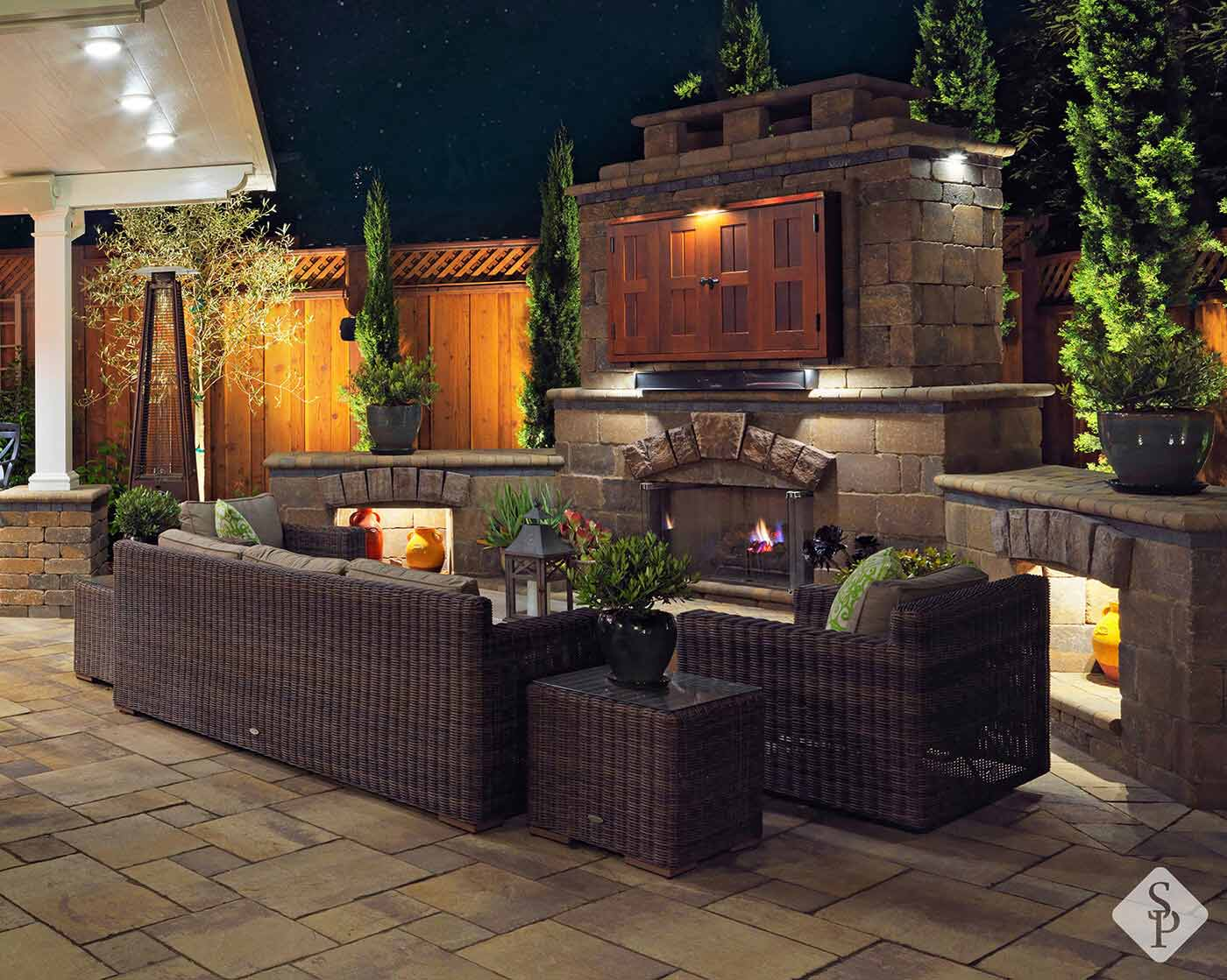 Late fall is the perfect time to make one outdoor addition that will not only provide benefit throughout the winter but also in the summer: An outdoor fireplace.